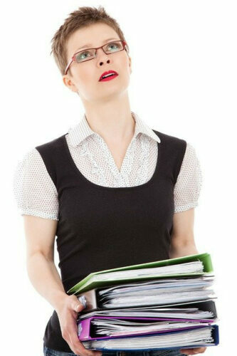 Lady carrying books and she is thinking about becoming an affiliate marketer