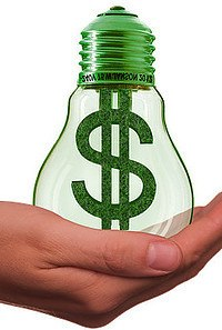 Light bulb in the hand with Dollar sign written on bulb